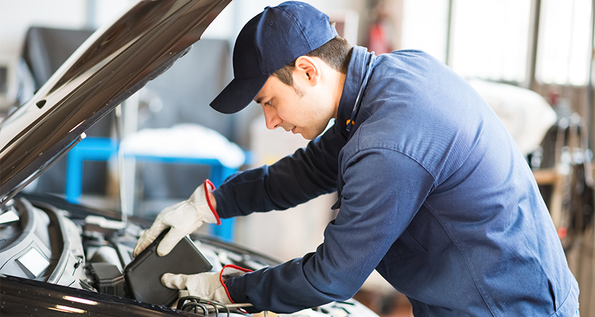 Technician undertaking car servicing - Car Servicing Northampton
